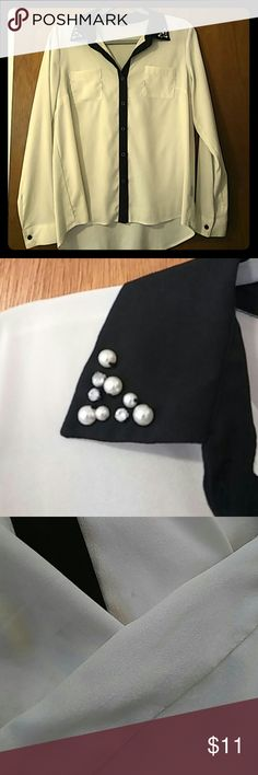 Gorgeous Ivory and Black Button Down Blouse Beautiful almost pearlized ivory flowy fabric with Black trim, collar and buttons. Collar has gemstones and pearl details. Some tiny, barely-noticeable marks (see 3rd pic). Only worn once or twice. Selling because not really the right size for me. Monteau Tops Button Down Shirts