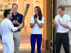PHOTO: William, Kate and Harry pose with the Olympic torch