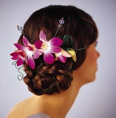 These are for the bridesmaids. An updo with orchids in the hair!