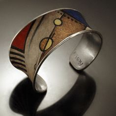 mm cuff by Revonav, via Flickr.  This gorgeous cuff combines polymer with metal = beautiful