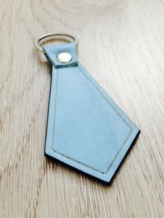 Hey, I found this really awesome Etsy listing at https://www.etsy.com/listing/240005446/necktie-blue-leather-key-chain-gift-for