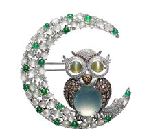 Fauna Creations - The Owl Inspired design that fashioned out of by the clever use of multicolored jade, with cats eyes and diamonds. Its body holds a mesmerizing Icy Jade. DeGem