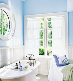 A limited palette of colors and materials adds serenity to a bath. Windows allow sun to pour in. Wrap the walls in beaded-board paneling. Cottage Style Bathrooms, Beach Cottage Style, Cottage Style Homes, Beach Cottage Decor, Beach House, Wainscoting Nursery, Wainscoting Styles, Wainscoting Height, Wainscoting Kitchen