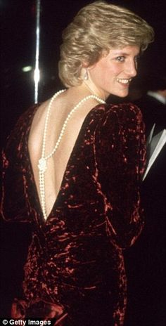 Princess Diana wore a Catherine Walker burgundy crushed velvet evening gown for a State visit to Australia and to the film premiere of 'Back to the Future' in 1985