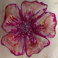 Recycle plastic bottles, make flowers to decorate cards or whatever!