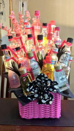 21st birthday gift! How to: Used 21 mini bottles to create a bouquet for my sister's 21st birthday. Pipe cleaners were wrapped around neck of each bottle and then wrapped around wooden bbq skewers. Skewers are pushed into a block of styrofoam I placed inside the basket.