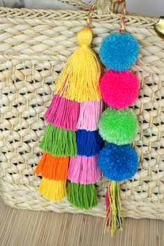 Pom pom bag charm Tassel bag charm Hot pink tassel bag charm Bag accessories Boho accessories Handbag charm Pom pom purse charm Pompoms Colorful bag charm made of hand crafted pom poms and tassels. Perfect for summer and beach bags. One size. Length without a loop: approx. 8.2