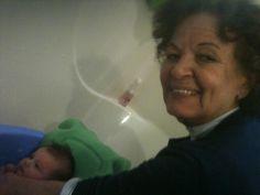Bisavo giving Myla bath!