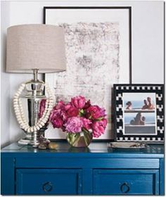 Blue dresser with oil rubbed bronze knobs- mixed with whites, neutrals, and pops of pink