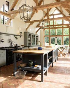 Kitchen in an oak-framed barn.   See this Instagram photo by @devolkitchens