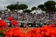Camila Giorgi of Italy in action against Dominika Cibulkova of Slovakiaon the Pietrangeli Court during day 3 of the Internazionali BNL d'Italia 2014