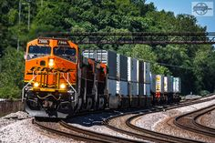 https://flic.kr/p/UXcXxA | Eastbound BNSF Intermodal Train at Sugar Creek, MO | BNSF Train Z LACCHI7 04L  Locomotives: BNSF 7966, BNSF 7439, BNSF 7033, BNSF 3903  6-6-17 Sugar Creek, MO