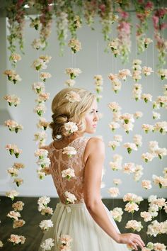 This handmade curtain of blush blooms makes for a dreamily romantic ceremony backdrop.