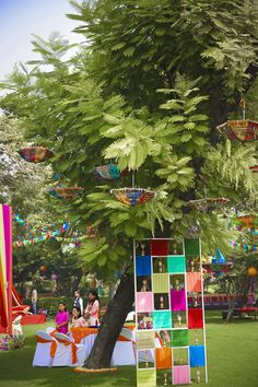 Looking for Colourful parasols and cloth decor on tree for mehendi? Browse of latest bridal photos, lehenga & jewelry designs, decor ideas, etc. on WedMeGood Gallery. Indian Wedding Poses, Indian Wedding Photography, Indian Wedding Planning, Indian Weddings, Real Weddings, Indian Wedding Decorations, Tree Decorations, Umbrella Decorations, Backdrop Decorations
