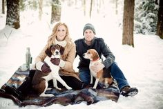 Winter engagement photo session in the snow with dogs.