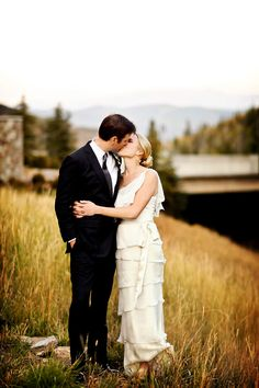The bride's gown is just lovely. Sweet photograph of the bride and groom. Photo: Pepper Nix Photography.