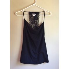 Lace Back Halter Black halter top with lace back and drape-neck front. Very flattering. Little wash wear on the side but very good condition. Fits a XS or S. So cute! Tops Tank Tops