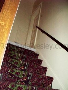 Elvis graceland staircases: stairs to kitchen from elvis bedroom