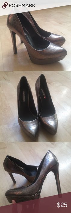 BCBG metallic bronze heels BCBG heels in excellent condition. Worn only once to a gala event! Size: US 6.5 BCBGeneration Shoes Heels