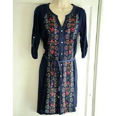 """NWOT Anthropologie TINY Plein Air shirtdress The Plein Air dress is one of my all-time favorites from Tiny, which sold out fast. I bought an XS and S because they were dwindling and I didn't know which fit better. I preferred the Small. So the Extra Small is new and has never been worn. Beautiful Navy with detailed floral embroidery in silver, red, green and gold. Measurements: bust: 17"""", front length: 34"""", back length: 36"""". Anthropologie Dresses"""