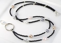 Beaded Lanyard MADEMOISELLE in black Pearls and by curlynetto, $15.99 Lanyard Necklace, Seed Bead Necklace, Beaded Necklace, Silver Pearls, Black Pearls, Beaded Shoes, Beaded Lanyards, Handmade Beaded Jewelry, Silver Engagement Rings