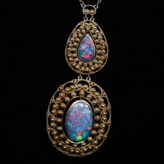 My favorite stone. I am very particular about it. Needs to shine tiny bits of red when light comes through. Black opal pendant necklace by Louis Comfort Tiffany