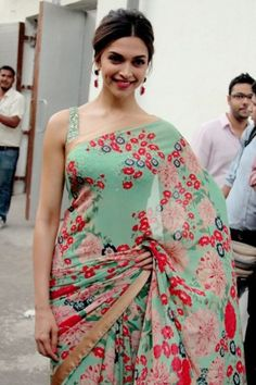 Deepika Padukone in a sea green floral saree with sleeveless sequed blouse