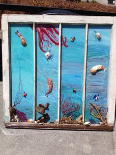 A window under the sea. Fish from shells and sea glass, shrimp made from shells too.