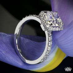 Stunning - A truly exquisite masterpiece, this Custom Halo Diamond Engagement Ring is set in 18k white gold and holds 0.45ctw A CUT ABOVE® Hearts and Arrows Diamond Melee. The 4 prong square halo securely holds a 1.81ct cushion cut diamond