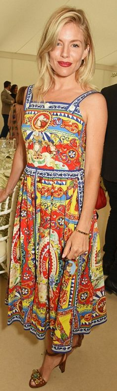 Sienna Miller in Dress, shoes, and purse – Dolce & Gabbana  Earrings and bracelet – Cartier