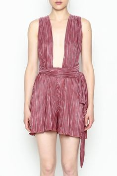 8762914aac This pink pleated tie romper features a sleeveless chic look for the  summertime. Pleated Tie. Shoptiques