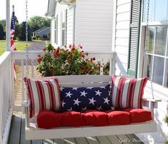 Look at this beautiful Americana-themed front porch!  Complete with a red, white & blue porch swing!