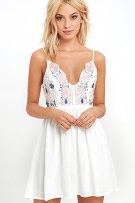 Fall in love to the rhythm of a steel drum band in the Down in Kokomo Ivory Embroidered Shift Dress! This vacation-ready number is made from lightweight rayon with short sleeves and a lace-up neckline. Black and blue embroidery decorates the shift bodice.