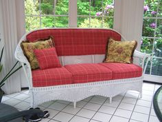 Repair, repaint and new 'country' fabric for a suite of Wicker furniture. www.capeneddickinteriors.com