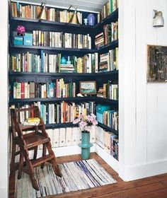 underused closet turned home library! love the glossy black shelves