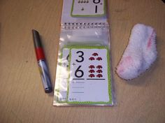 use dollar store photo album for flashcards and dry erase