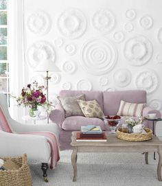 Ceiling Medallions on the Wall. Saw this is Country Living...such a creative way to add texture to a boring white wall.