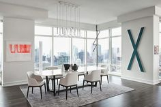 Dining room in Modern apartment by Tara Benet in New York