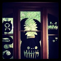 Cheap and easy Halloween decorations with just black wrapping paper, scissors and tape.