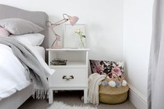 Grey, white & blush bedroom with warm metallic accents and Luna bed from Loaf.com, Ikea furniture, vintage mirrors and chalk pink lamps