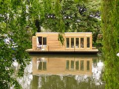 """The Eco Floating Home's ethos is """"to construct healthy, ethical homes that enhance the countryside and deliver maximum comfort with minimum energy bills and a small carbon footprint."""" These homes utilize energy efficiently by harnessing natural light, incorporate solar heating, photo galvanic cladding, waste and water treatment, and passive energy control systems like green roofs"""