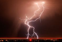 8/21/2012  Lightning illuminates the sky along Airport Road in Billings, Mont.