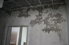 Sure would love this on an outside patio wall! Sandblasted and tinted concrete tree shadows