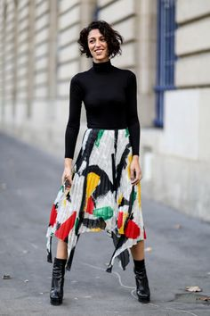 SHOP THE LOOK: PFW live: Arty party A brush stroke or some paint-spray - the arty trend is big in our dressings this years, Yasmin Sewell wears it a on a pleated skirt during Paris Fashion Week.