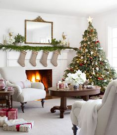 The owner of this Oregon farmhouse hung Suzanne Kasler stockings from Ballard Designs on her mantel.
