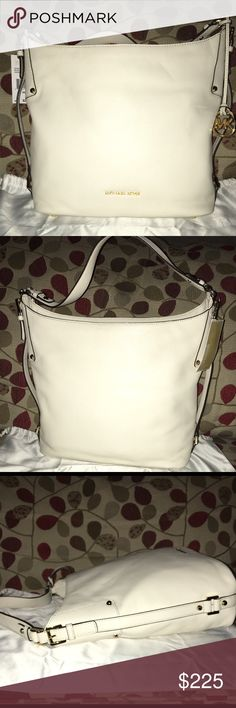 """NWT Bedford LG Belted Shoulder Bag New MK Befford Belted Bag in Ecru & Gold hardware! Gorgeous bag ladies! Sophisticated & Stunning! It's Logo lined, key fob, 1 zip, multiple slip pockets and amazing belt accents on the sides! Did I mention Stunning? Can't forget the feet on the bottom to protect this beauty! Shoulder strap is 10"""" bag measures approx 12.5 X 9 X 5.25 no trades price firm MICHAEL Michael Kors Bags Shoulder Bags"""
