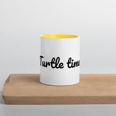 Turtle time design mug-add a splash of color to your morning coffee or tea ritual! These ceramic mugs not only have a beautiful design on them, but also a colourful rim, handle, and inside, so the mug is bound to spice up your mug rack. Turtle Time, Mug Rack, Office Suite, Time Design, Slogan Tee, Ceramic Mugs, How To Know, Morning Coffee, Spice Things Up