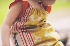 Little girls scooter dress  - Linen Echino print of vespas with organic orange cotton sleeves.