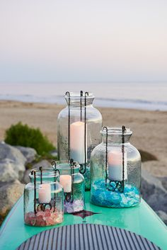 Like long-lost glass jars that have been discovered and repurposed, these handblown Hanging Pillar Jar Hurricanes from Pier 1 take on a warm glow, indoors or out. The handcrafted, hammered iron inset is sturdy enough to hold a pillar candle. Talk about taking rustic chic and kicking it up a notch. Or two.