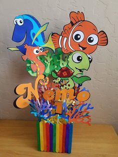 This listing consist of 1 Set Finding Nemo/Dory Centerpiece. You have 2 option for Centerpiece. 1st Set (Nemo and Dory Centerpiece with Name and Age) You will receive: 4 Characters (DIE CUT NOT PRINTED), 2 Big Seaweeds, 7 small Seaweeds, Name and Age 1 NEMO DIE CUT measures 5